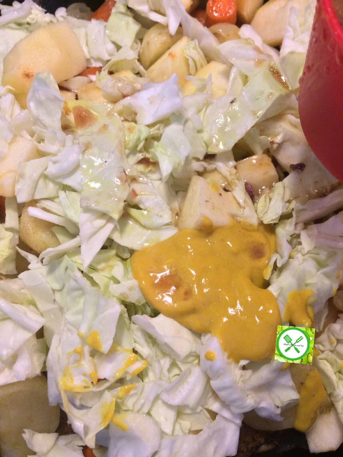 Braised chicken with veggies add mustard