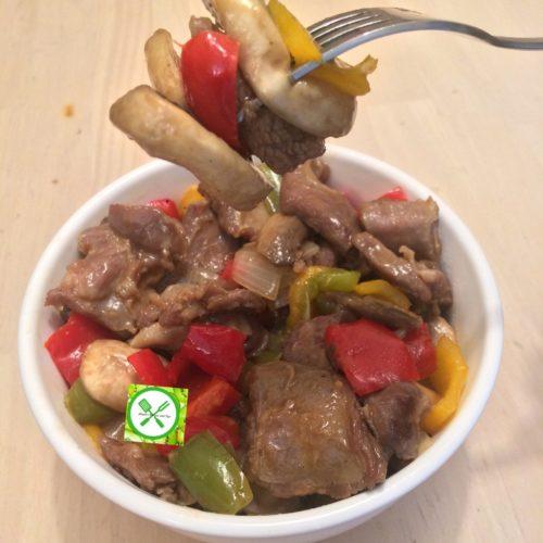 Goat n mushrooms in a plate