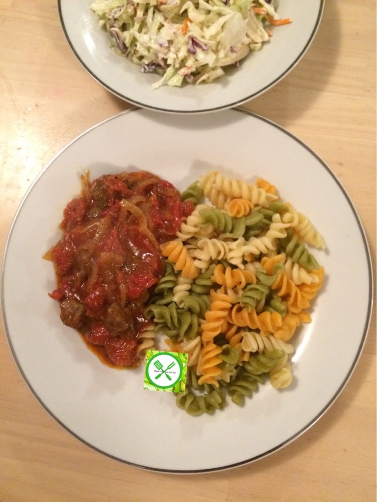 pasta with tomato beef sauce served