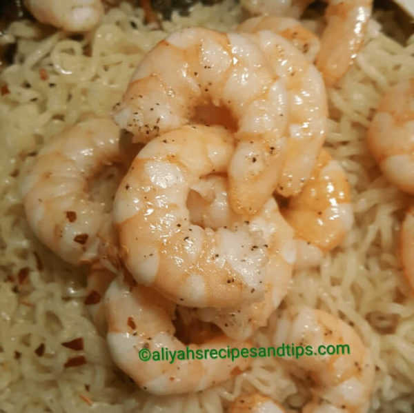 Remove the shrimps, red pepper flake, and noodles. Combine and allow to warm up. Check the season and readjust if necessary.