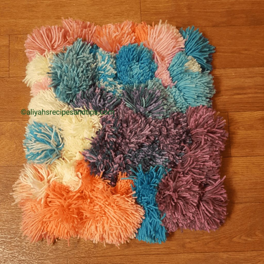 how to, pom, pom pom rug, craft, diy, diy pom pom, living room, purple, baby, yarn, handmade, handmade pom pom rug, handmade pom pom kit, pom pom kit